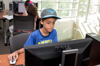 Zamar Wisner works on his assignment in the O'Connor computer labs, for the Young Writers Camp.