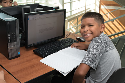 Trae Garcia works on his assignment during the Young Writers Camp.