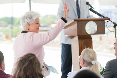 Mayor Nelda Martinez stands to be recognized during the Momentum Village phase 2 ground breaking ceremony.