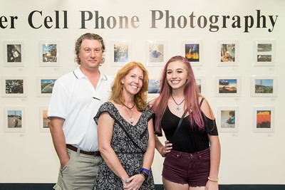 Karl (left) Jennifer and Maggie Weir during the Islander Cell Phone Photography Show at the Mary and Jeff Bell Library.