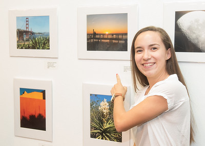 Alexandria Rossi points to the artwork she submitted to the Islander Cell phone Photography Show.