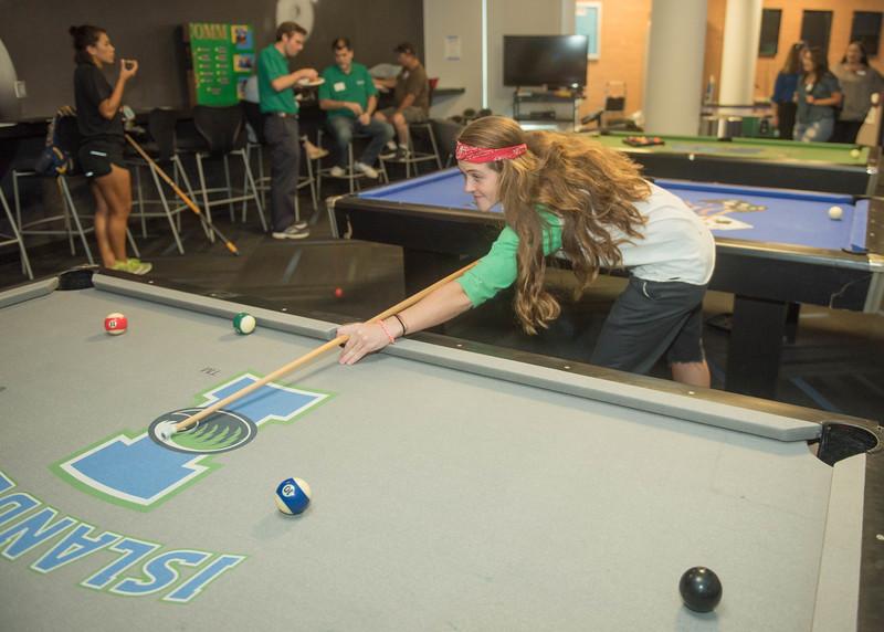 Student Savannah Ryan playing pool at the Comm Club mixer.