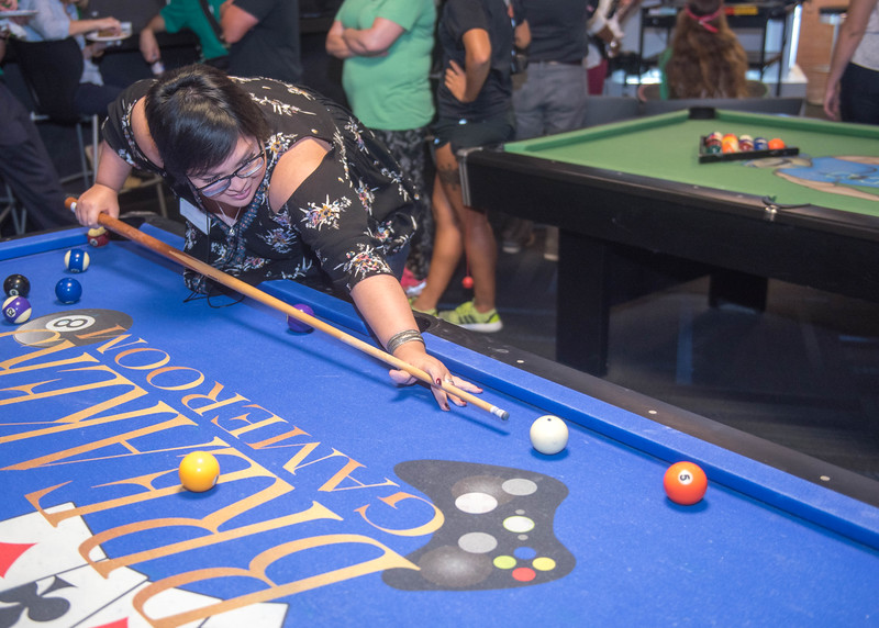 Student Emily Hernandez playing pool at the Comm Club mixer.