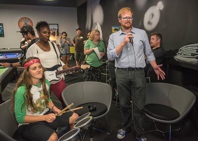 (Left to Right) Savannah Ryan, Kendra Johnson, and David Gurney playing Rock Band at the Comm Club Mixer.
