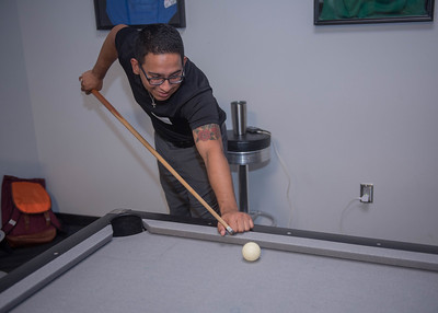 Student Marco Graciani playing pool at the Comm Club mixer.