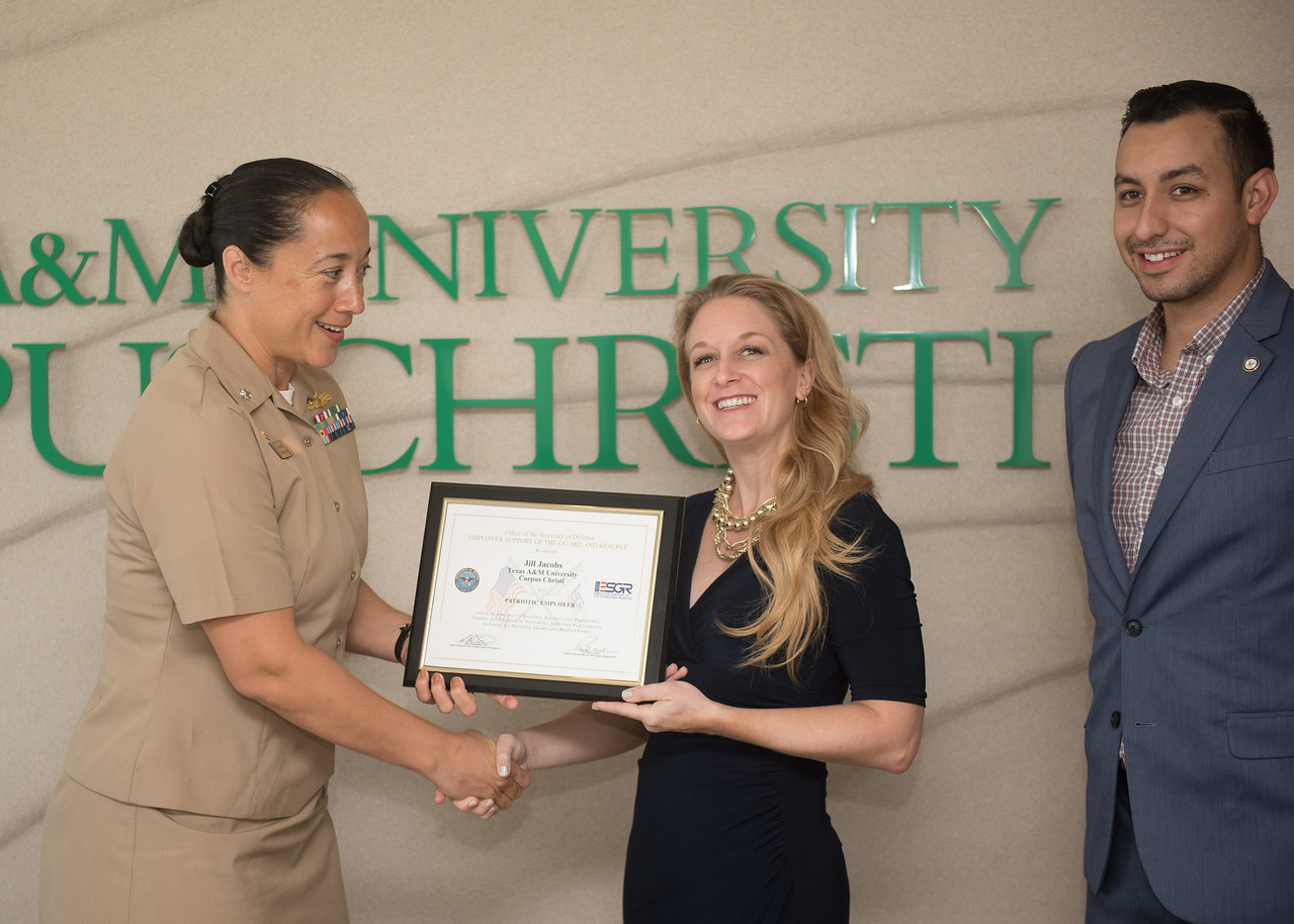 TAMU-CC executive directo Jill Jacobs (center) recieves recognition as a patriotic employer from the US Navy.