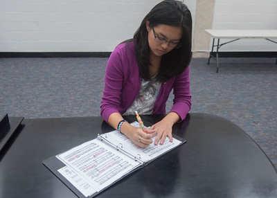 Student Crystal Aguilar makes notes for the upcoming preformance.