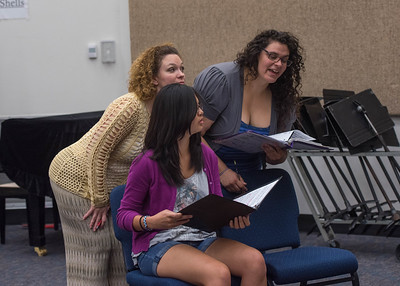 Dr. Thacker helping students Crystal Aguilar and Jillian Scaff during their rehearsal.