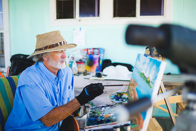 Artist in residence Jeff McDaniel works on one of his many art pieces produced during his stay at the Laguna Madre Field Station.