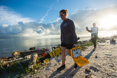 Emily Cira(left) and Jessica Tolan - research technicians under Dr. Wetz life sciences program. Release the ECO Mapper an autonomous underwater vehicle (AUV) used to collect data to survey bodies of water.