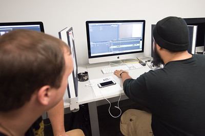 Gabriel Parker III (left) and Michael Rene Montero work on their video production in the Media Lab in Bay Hall.