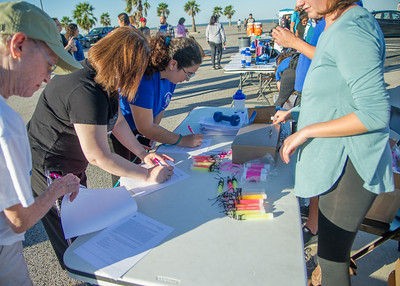 People signing up for the Paws for Cause event.
