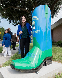 TAMU-CC Katarina Chapa poses next to the newly unveiled Islander boot in the City of Mercedes, TX.