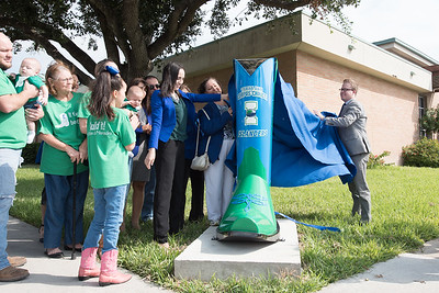 Katarina Chapa (left) and Russell Wagner (right) unveil the TAMU-CC boot in the City of Mercedes, TX.