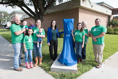 Katarina Chapa and her family pose next to the TAMU-CC boot before the unveiling in Mercedes, TX.