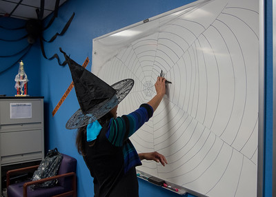 Honors Director Elizibeth Shope playing pin the spider on the web.