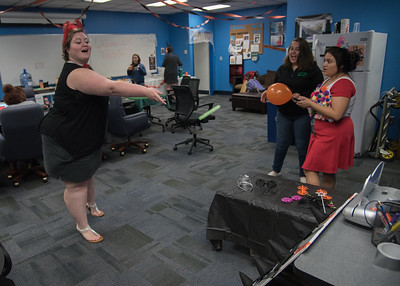Student Karen Ward playing ring toss at the honors open house.