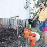 Melissa Zamora explains the differences between mature and nitrogen rich compost at the islander garden.