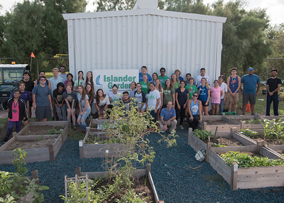 Group photo with the guests at the event and the Green team.