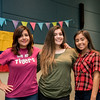 Karla Zamora, Patricia Galbraith, and Andrea Barrendey gather for a photo at the Colombian Carnival event in the UC.