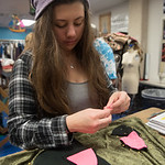 Coral Harris pins togher cat ears for a hat to be presented to kids at Driscoll Children's Hospital