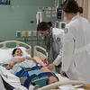Nursing students set up a simulation.