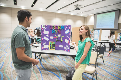 Lorenzo Diaz (left) listens to Vivian Ramirez's presentation during the Green Campus Poster Fair in the Anchor Ballroom.
