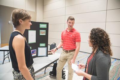 Morgan McCutchen (left) Daniel Green and Stephanie Cantu take part in the Green Campus Poster Fair.