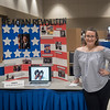 Student Kendal Larocque with her poster over the Reagan Revolution.