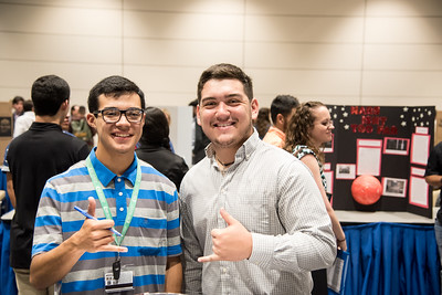 TAMUCC Students Matthew Martinez(left) and Ryan Ramirez(right) show their islander spirit at the First Year Symposium with smiles and shakas.