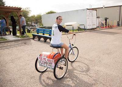 Student Maria Cherry riding the Islander Green Team bicycle.