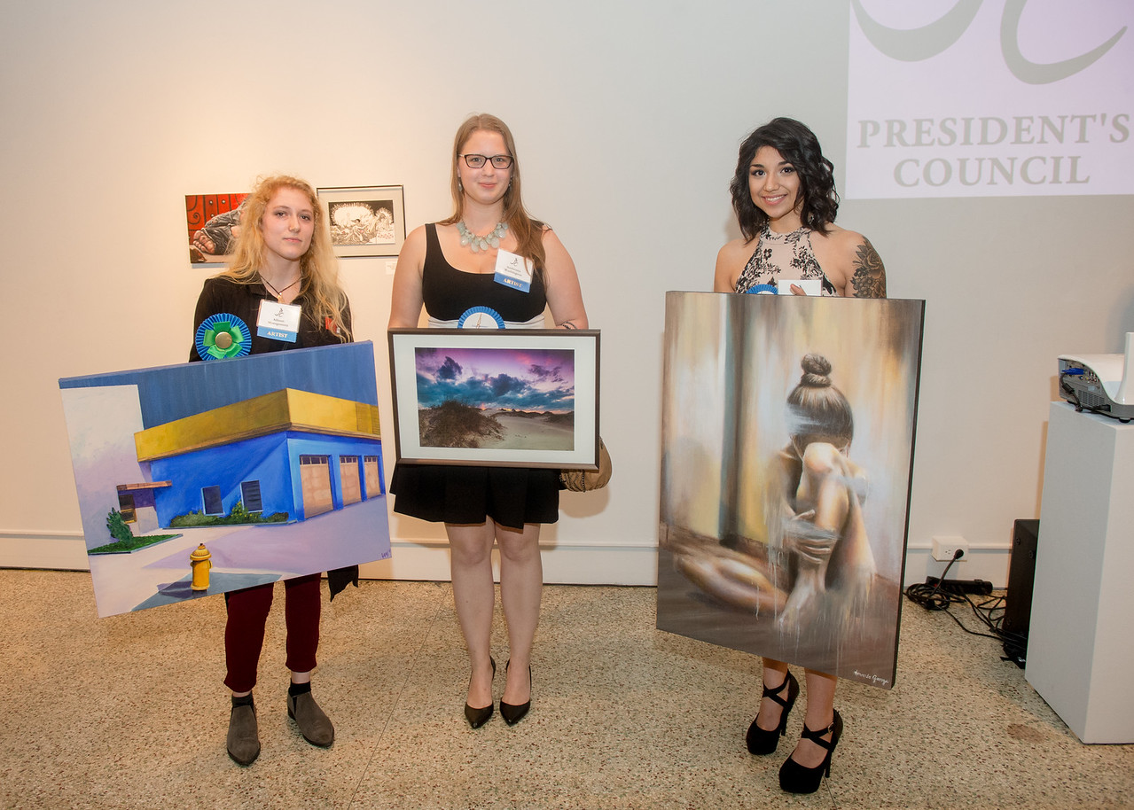 3rd place winner Allison Montgomery with her art piece uptown oil. 2nd place winner Ambrosia Washington with her art piece titled Morning - photography. First place winner Amanda Garza with  ...