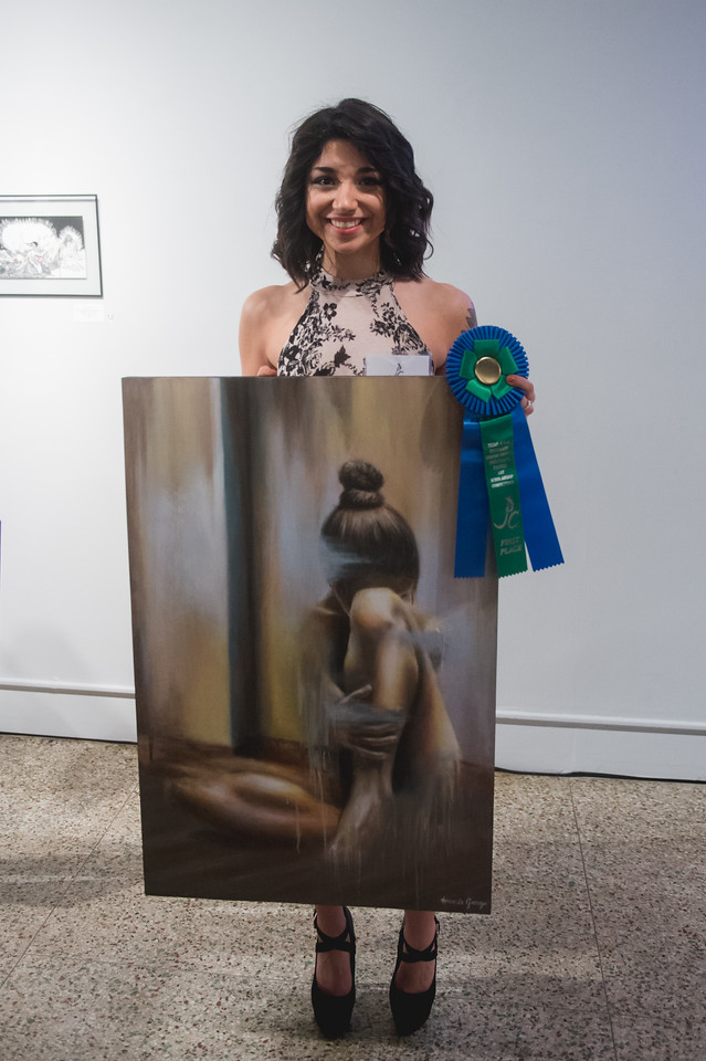 First place winner Amanda Garza with art piece titled transparent - oil