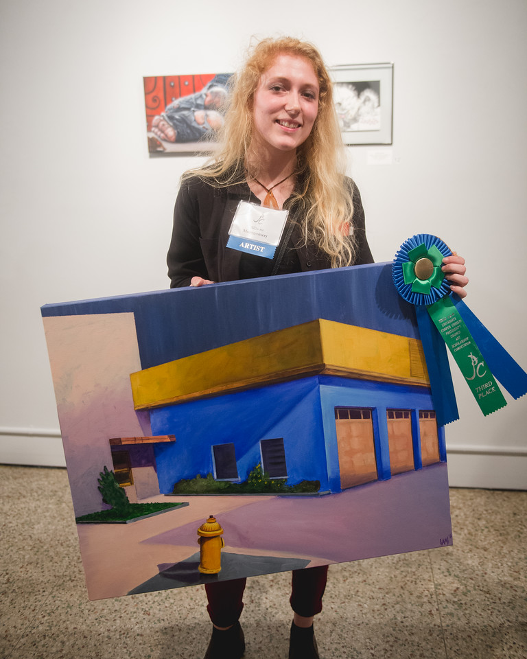 Third place winner Allison Montgomery with her art piece uptown - oil.