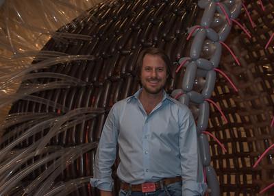The artist Jason Hackenwerth next to his piece