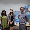 Students (left to right) Hannah Ayodele, Brittey Skinner, and Ryan Morland next to their poster presentation on Church Without Walls.