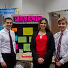 Students Joseph Chavez, Chelsea Flores, and Richard A Schreiber next to their poster for the P.A.A.C.
