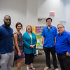 Executive Director of Habitat For Humanity Corpus Christi Barbary Sweeney with students (left to right) Mack Chambers, Alex Hanna, Austin Green, and Roman Longoria.
