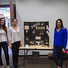 Students Miranda Klaproth, Khloe Nguyen, and Rebecca Flores next to their poster on the Food Bank of Corpus Christi