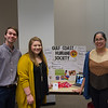 Students Blake Clarke, Kara Herrera, and Callen Matejek next to their presentation over the Gulf Coast Humane Society.