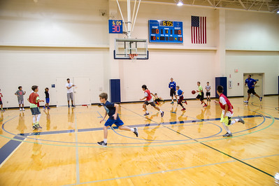 Islander students Elijan Schmidt and Cole Martinez coach a group of kids at the 2016 summer basketball camp