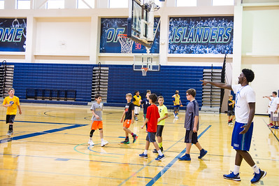 Islander student Rashawn Thomas coaches a group of kids at the 2016 summer basketball camp