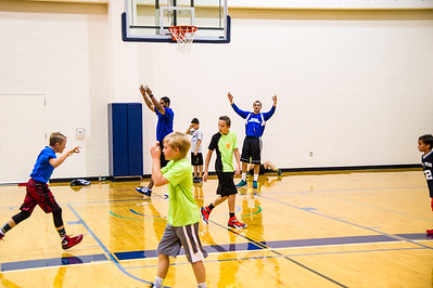 Islander student Cole Martinez celebrates with his group of kids that he coaches at the 2016 summer basketball camp