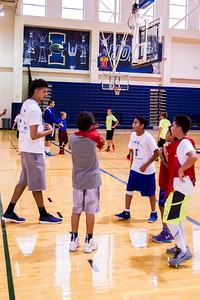 iIslander student Elijan Schmidt coaches kids at the 2016 summer basketball camp
