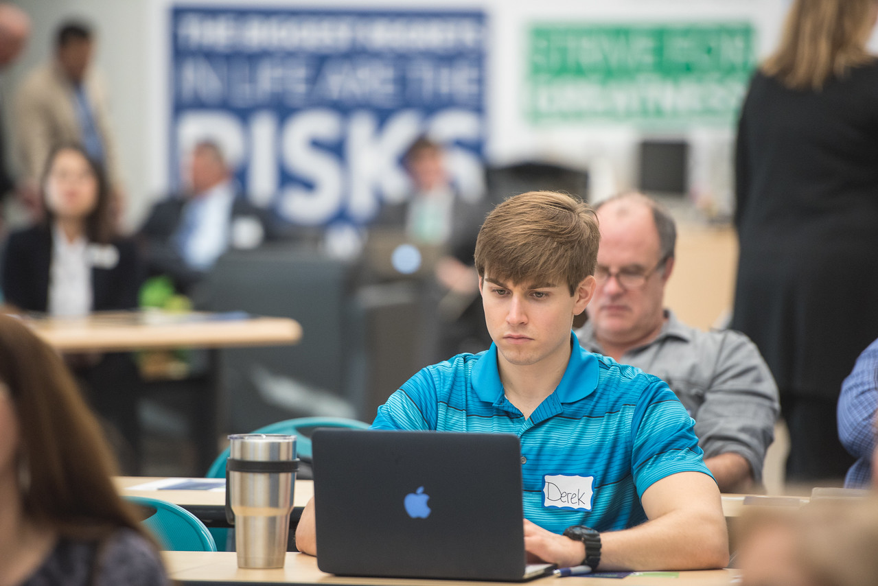 Islander alumnus Derek Drozd takes notes during the patents and trademarks educational workshop in the Coastal Bend Business Innovation Center.
