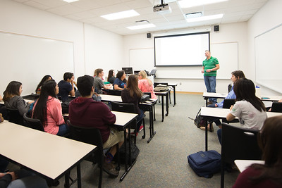 Dr. Mark McNamara asks students to introduce themselves during the first day of class.