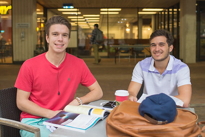 Steven Francisco (left) and Michael Fischer catch up on reading between classes.
