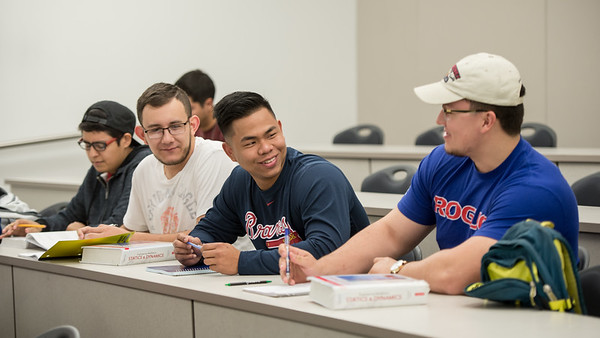 Jonathan Reynolds (right) Christian Murillo, Raymundo Silva and Jose Anguiano prepare for their dynamics class in the O'Connor building.