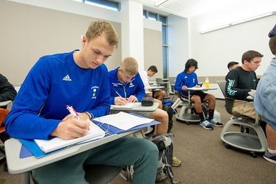 Lukas Buth (left) and Daniel Vellenbeuz take notes during their freshmen seminar in the O'Connor building.