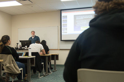 Dr. John Wood during a presentation for his environmental biology class in Island Hall.